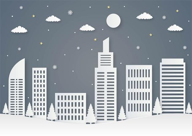 Prettige kerstdagen en gelukkig nieuwjaar papier gesneden kaart met stad op blauwe achtergrond