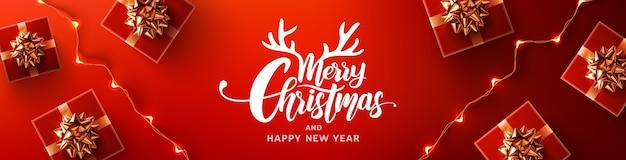 Prettige kerstdagen en gelukkig nieuwjaar promotie poster of banner met rode geschenkdoos en led lichtslingers
