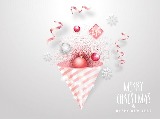 Prettige kerstdagen en gelukkig nieuwjaar viering wenskaart met partij popper, kerstballen, sneeuwvlok en geschenkdoos op wit.