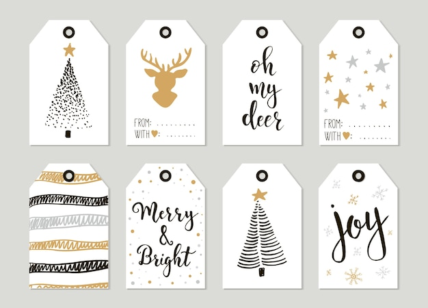 Prettige kerstdagen en gelukkig nieuwjaar vintage cadeau-tags en kaarten met kalligrafie. handgeschreven letters. hand getrokken ontwerpelementen. afdrukbare items