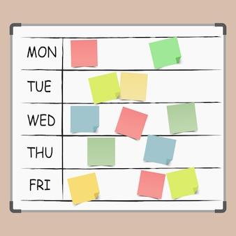 Prikbord vol met notitiebriefjes. agenda, takenlijst.