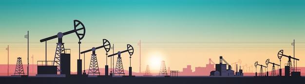 Pumpjack aardolieproductie handel olie-industrie concept pompen industriële apparatuur booreiland zonsondergang achtergrond horizontaal
