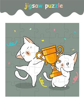 Puzzelspel van schattige katten is winnaar