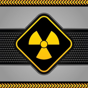 Radioactief symbool, abstract industrieel malplaatje als achtergrond