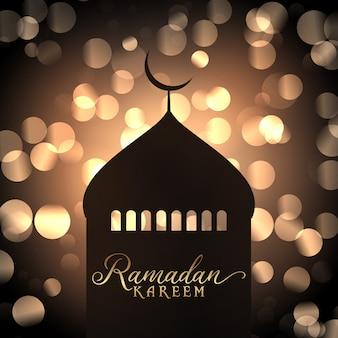 Ramadan kareem-achtergrond met moskeesilhouet tegen gouden bokehlichten