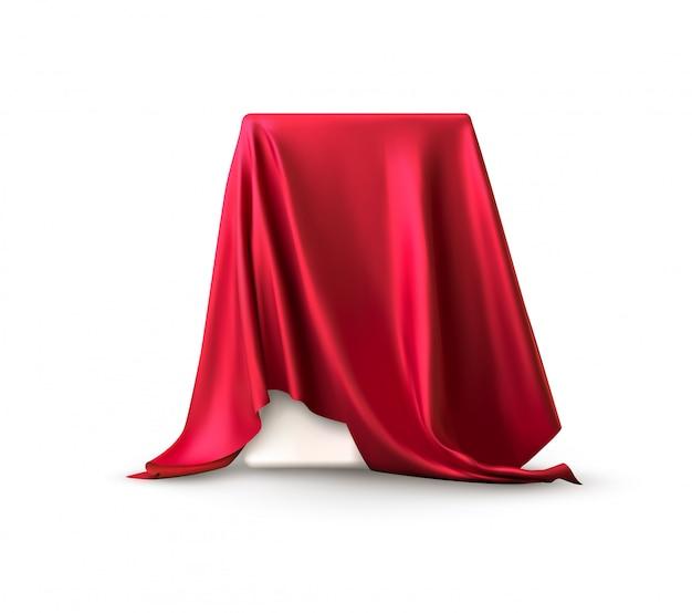 Realistische doos bedekt met rode zijden doek.