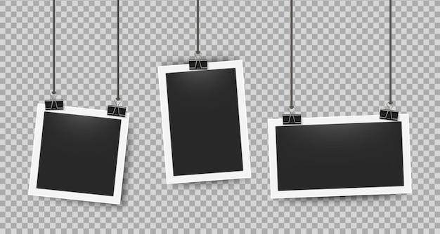 Realistische fotolijsten geknipt op touwen. retro 3d afbeeldingsframe op witte rand voor camera's fotografie. vector illustratie leeg fotolijstje ingesteld op transparante achtergrond