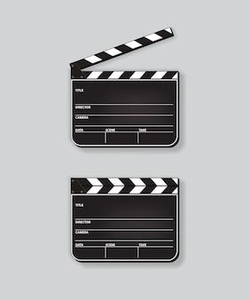 Realistische geopende en gesloten filmklapper op grijze achtergrond.