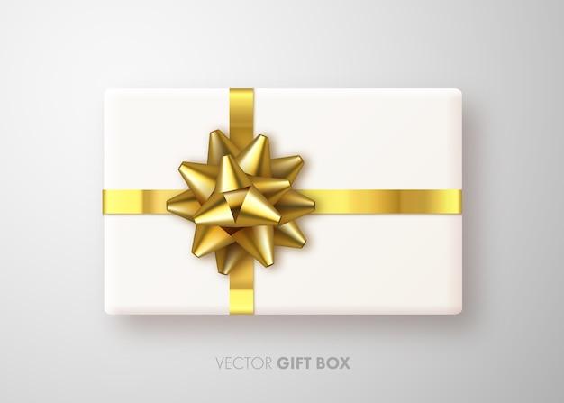 Realistische geschenkdoos met gouden strik Premium Vector