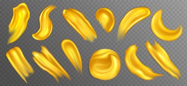 Realistische gouden acrylverf uitstrijkjes of druppels