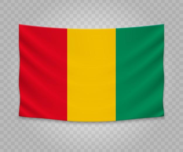 Realistische hangende vlag van guinee