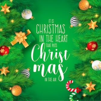 Realistische Kerst achtergrond met ornamenten en citaat