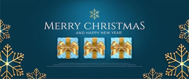 Realistische kerstbannerviering in blauwe en gouden sneeuwvlok