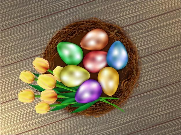 Realistische kleurrijke paaseieren in de mand