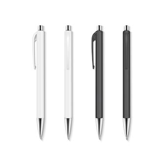 Realistische set witte en zwarte automatische balpennen.