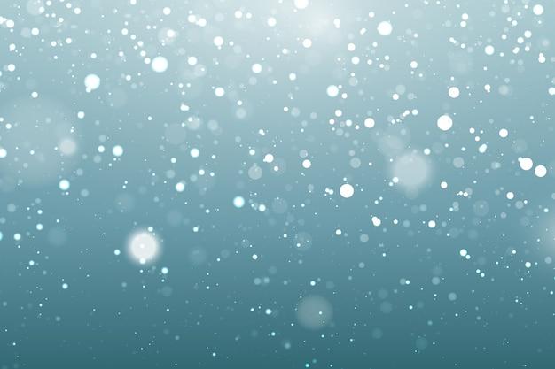 Realistische sneeuwvalachtergrond met bokehelementen