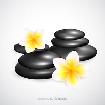 Realistische spa stenen met bloemen