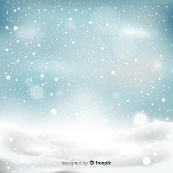 Realistische vallende sneeuwvlokken op hemelachtergrond