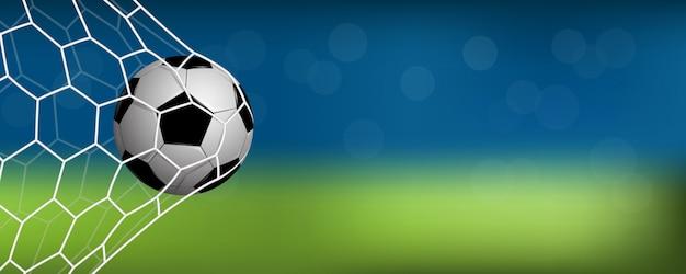 Realistische voetbal in net met kopie ruimte voor tekst