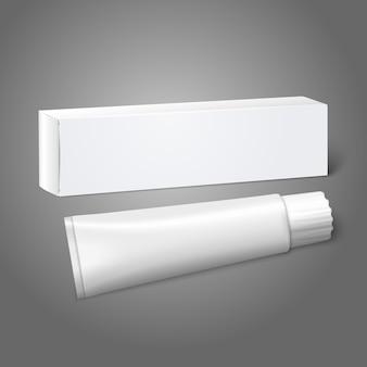 Realistische witte blanco papieren pakketdoos met buis voor langwerpige spullen - tandpasta, cosmetica, medicijnen enz. op grijze achtergrond voor en branding.