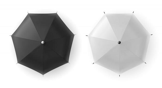 Realistische witte en zwarte lege parapluclose-up die op witte achtergrond wordt geïsoleerd.