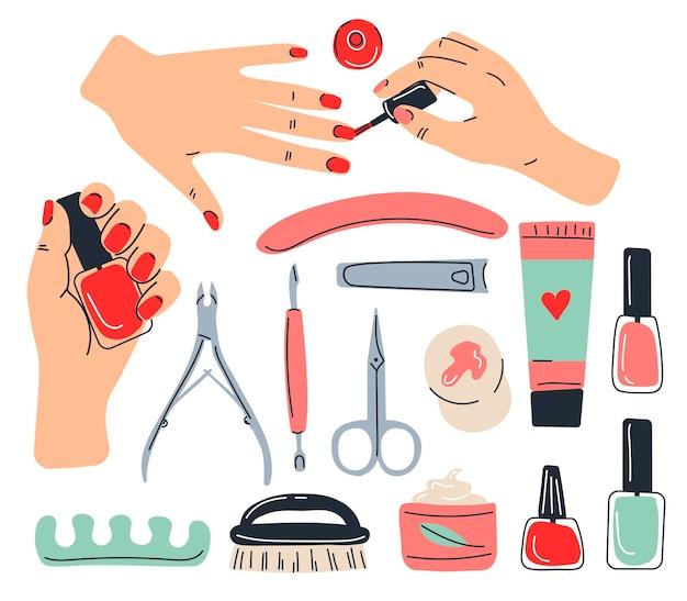 Reeks hulpmiddelen voor manicure op wit wordt geïsoleerd dat
