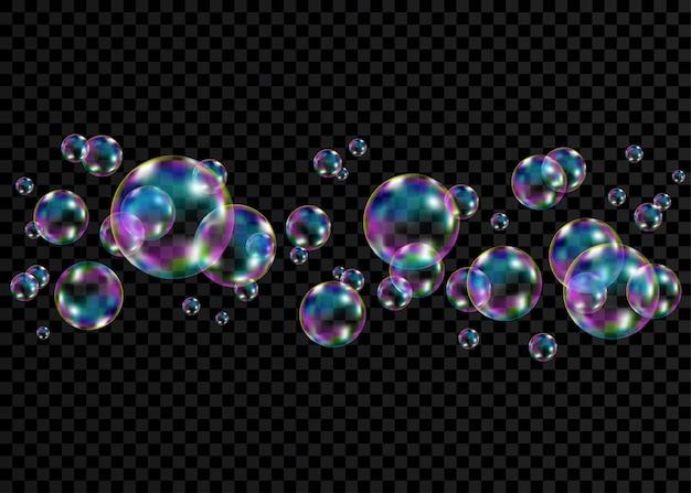 Reeks realistische transparante kleurrijke zeepbellen met geïsoleerde regenboogbezinning