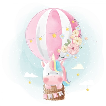 Regenboog eenhoorn die met ballon vliegt