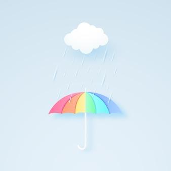 Regenboogkleurige paraplu met regen en wolk, regenseizoen, regenbui, papierkunststijl