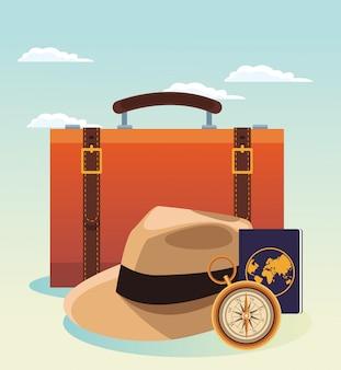 Reiskoffer en hoed met kompas en paspoort