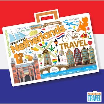 Reizen naar nederland. stel dutchicons en symbolen in de vorm van een koffer