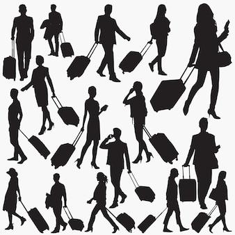 Reizigers met koffer silhouetten
