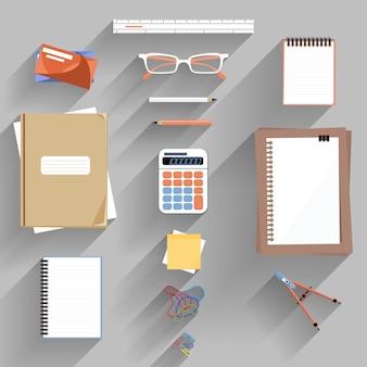 Rekenmachine, liniaal en papier op een bureau