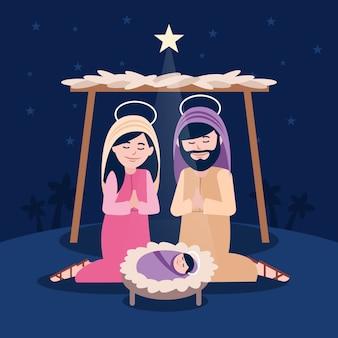 Religieuze kerststal met biddende mensen