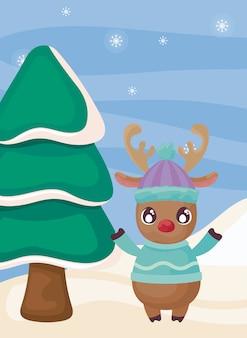 Rendier met kerstboom op winterlandschap
