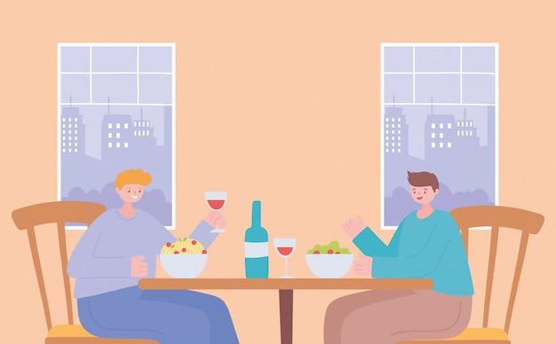 Restaurant sociale afstand, mannen eten aan tafel nieuw normaal leven, pandemie, preventie van coronavirusinfectie