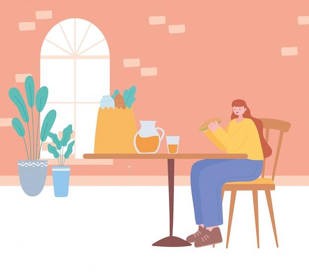 Restaurant sociale afstand, vrouw alleen eten in tafel, pandemie, preventie van coronavirusinfectie