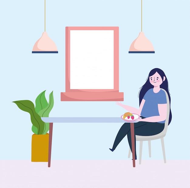 Restaurant sociale afstand, vrouw die fruit en brood alleen in tafel eet, preventie coronavirus
