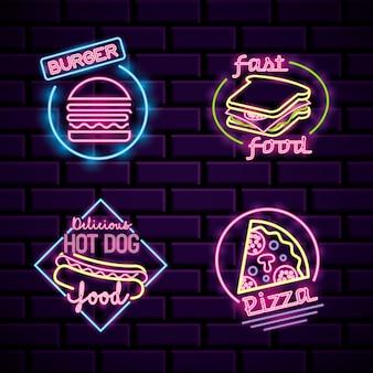 Restaurantneonlichten die op bakstenen muur adverteren