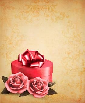 Retro achtergrond met mooie rode rozen en geschenkdoos.