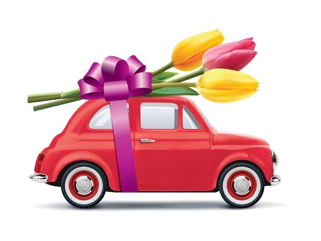 Retro auto met tulpen op wit wordt geïsoleerd