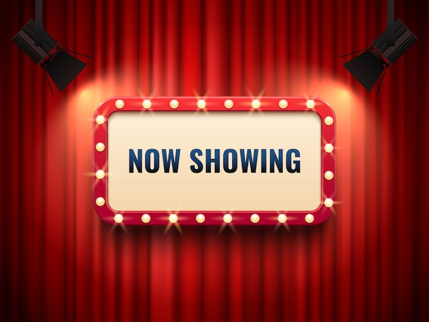 Retro bioscoop of theaterraam verlicht door schijnwerpers.