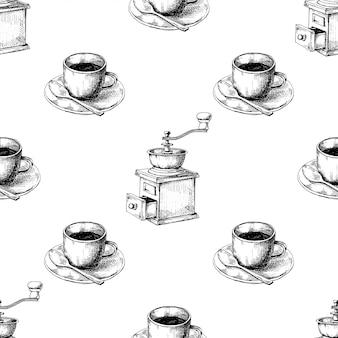 Retro handmatige koffiemolen of molen en mok koffie op een schoteltje.