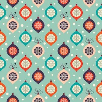 Retro kerst patroon met decoratieve kerstballen en sneeuwvlokken