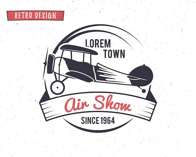 Retro logo-ontwerp met een vliegtuig op airshow