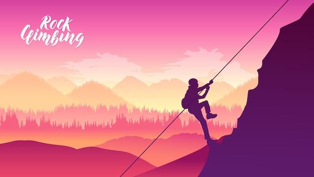 Rock klimmer rusten tijdens het beklimmen van overhangende klif