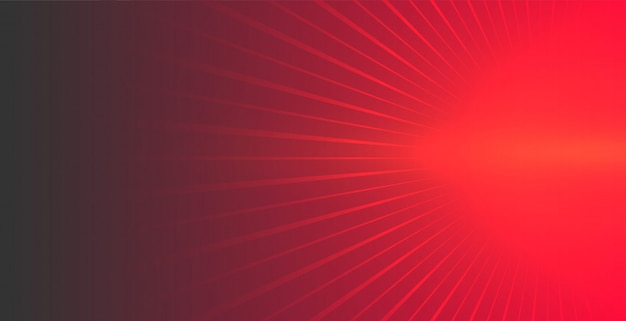 Rode achtergrond met gloeiende stralen die naar voren komen