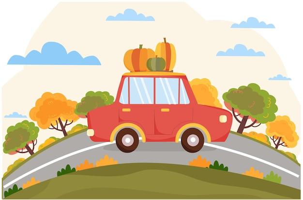 Rode auto met pompoenen rijdt op de weg herfstseizoen achtergrond met autowegbomen