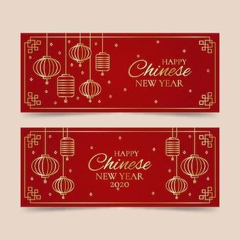 Rode en gouden chinese nieuwe geplaatste banners van het nieuwjaar