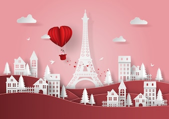 Rode hartvormige ballon zwevend boven het dorp